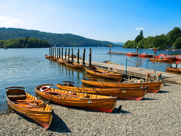 several boats lined up on the edge of the Lake District