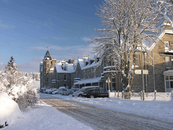 snow covered buildings in Scotland