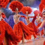 dancing women dressed in exotic red outfits