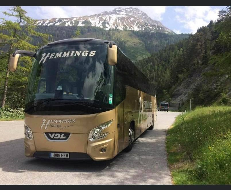 A Hemmings coach driving through countryside