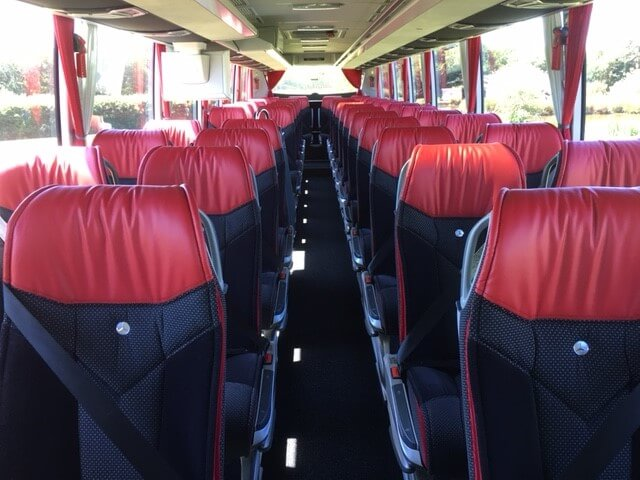 an interior shot of the seats inside a coach